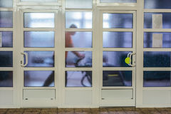 People at work. The man behind a glass partition rubs floor Stock Photo