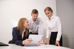 3 people work in the office Royalty Free Stock Photography