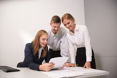 3 people work in the office Stock Image