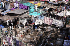 People work at the open-air laundry in Mumbai royalty free stock images