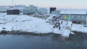 People work on pier of Antarctic polar station - Vernadsky. View of robotic arm.