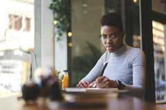 People at work publishing on web page of issue online version sitting in modern cafe royalty free stock photography