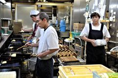 Kyoto shopping center. People at work in a restaurant kitchen in a shopping mall in Kyoto royalty free stock images