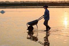 People work on salt fields in Hon Khoi, Khanh Hoa, Vietnam Royalty Free Stock Image