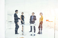 People at work t sales using internet and social networks collaborating in office stock image