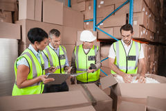 People at work in warehouse Stock Photos