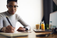 People at work. Young experienced administrative manager providing organization in office making checklist and schedule for staff members monitoring productivity Royalty Free Stock Image