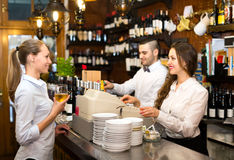 People working at a bar stock image