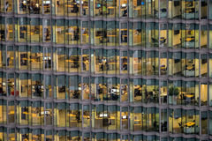 People working in a busy office building Stock Photography