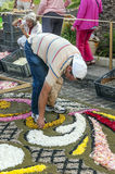 People working in the carpet of flowers. In la Orotava in June 2014, it´s a vertical picture Royalty Free Stock Image