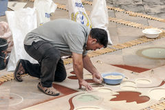 People working in the carpet of sand Royalty Free Stock Photography