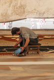 People working in the carpet of sand Stock Image