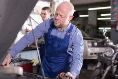 People  working at carshop Royalty Free Stock Image