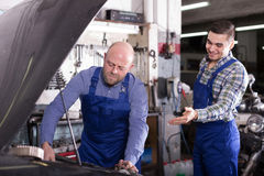People  working at carshop Stock Images