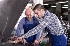 People  working at carshop Royalty Free Stock Images