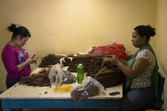 People working in a cigar factory Stock Images