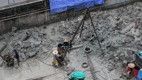 People working at the construction site in Bangkok, Thailand stock footage