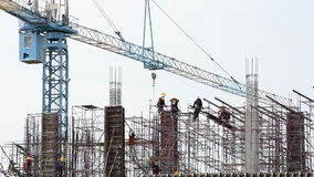 People working in construction site. People working in big construction site stock footage