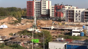 People working in construction site. Painting new flat house. VILNIUS, LITHUANIA - NOVEMBER 17, 2014: People working in construction site on November 17, 2014 in stock video footage