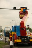 People is working on crane. For install new traffic ligh stock photography