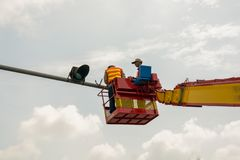People is working on crane. For install new traffic ligh royalty free stock photos