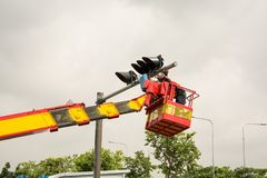 People is working on crane. For install new traffic ligh royalty free stock image