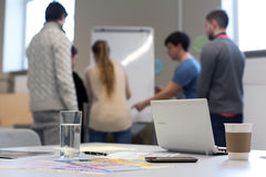 People working at Flip chart business items on Table. Group of People working at Office Flip Chart discussion Ideas Business Items on grey Desk at Foreground stock images
