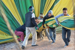 People working with hot air balloon. Egyptian people working on hot air balloon royalty free stock photos