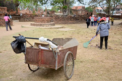 People working keep garbage at Wat Mahathat. On February 29, 2016 in Ayutthaya, Thailand Royalty Free Stock Images