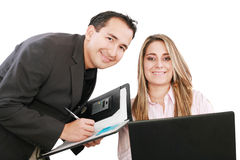 People working on a laptop during a meeting. Cheerful business people working on a laptop during a meeting Stock Photos