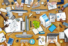People Working at Messy Table Royalty Free Stock Image