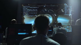 People working in mission control center stock footage