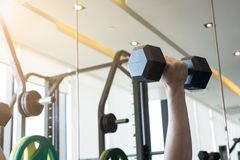 People are working out with dumbbells. Exercise for good healthy concept Stock Photo