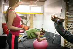 People working out in the gym. Royalty Free Stock Photography