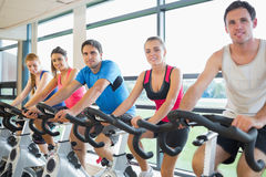 People working out at spinning class Stock Images
