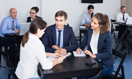 People working productively on business project together Stock Image
