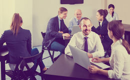 People working productively on business project together Stock Photos