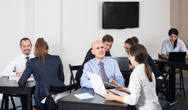 People working productively on business project together. In office Royalty Free Stock Photo