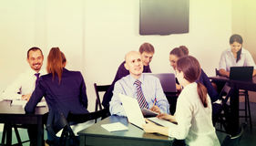 People working productively on business project together royalty free stock photography