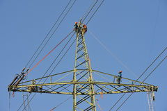 People working on pylon tower. With high tension electrical power lines Royalty Free Stock Photo