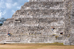 People working at the restoration of El Castillo in Chichen Itza. royalty free stock image