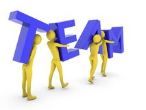 People working together carrying blue Team letters Royalty Free Stock Photography