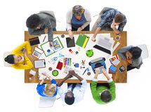 People Working Together on a Conference Table Royalty Free Stock Photography