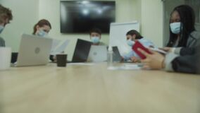 People are working together in the office room and looking through documents