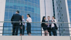 People working together outdoors. They discuss their plans and graphics. People working together outdoors. They discuss their plans, graphics and projects for stock footage