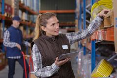 People working at warehouse. Warehouse stock photography