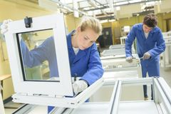 People working in window factory royalty free stock photos