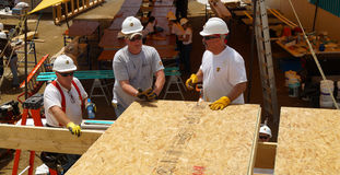 People working in wood rooftop Royalty Free Stock Image