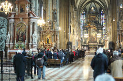 People worship god in Church of St. Stephen. In Vienna, Austria, indoors, shalow depth of field Stock Photo