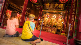 People worship on Three Buddha gold statue chinese style in Wat Leng Nei Yee Chinese temple Stock Photo